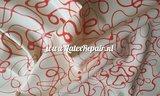 latex sheet rubber rood wit lijnen krullen catsuit